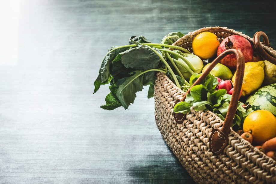 seasonal food in a basket included fruit and veg,
